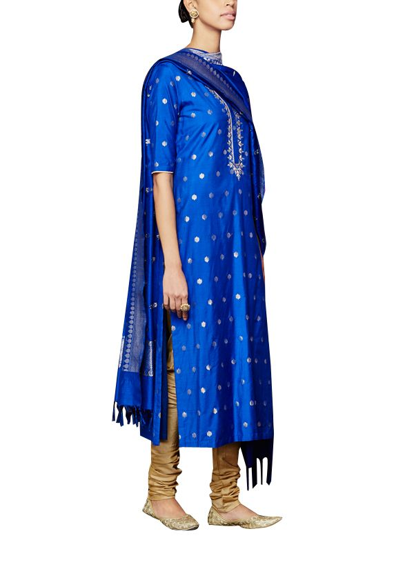 A beautiful blue Benaras brocade cotton silk kurta with gota patti and resham embroidery all over, paired with a golden churidaar and blue dupatta. Team this anarkali suit with golden mojris and jadau earrings for a classic traditional look. For an alternate look, pair the kurta with a golden sharara.