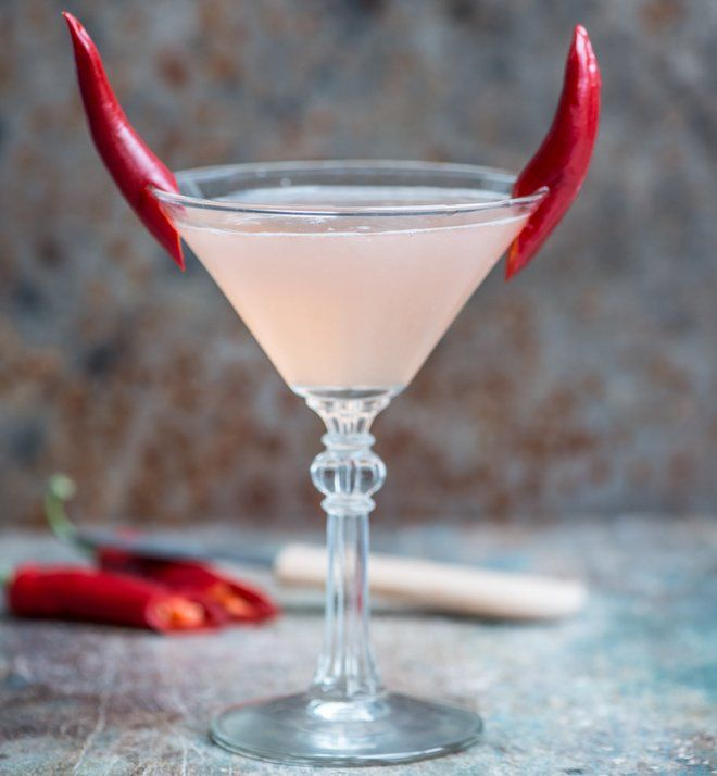 Cocktail garnished with chili pepper 'horns'                                                                                                                                                                                 More