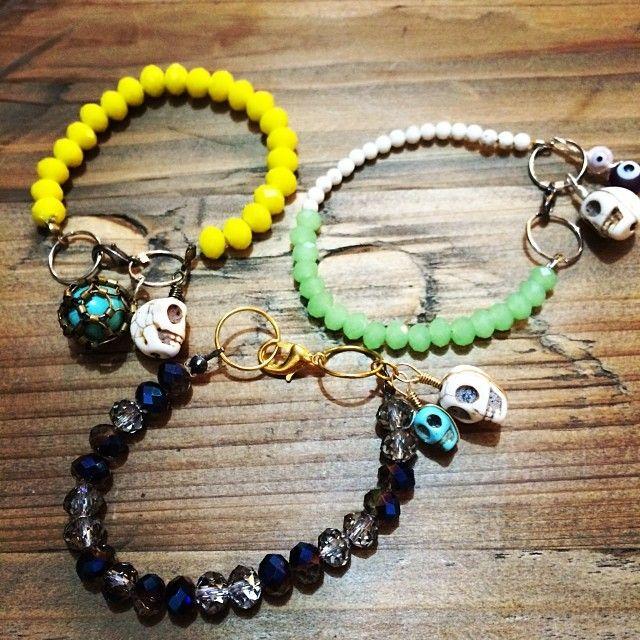 "@Somsri's photo: ""Various crystal bracelets with skull, evil eye and imprisoned bead charms."" #jewellery #handmade #jewelry #crystals #somsri #gemstone #bracelet #skull #evileye"