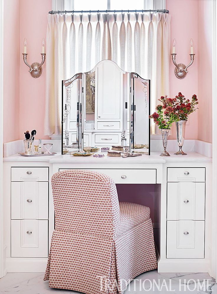 A vanity table was built into a niche with a north-facing window, providing soft light for applying makeup and grooming. - Photo: Emily Jenkins Followill / Design: Carolyn Kendall with Betsy Trabue