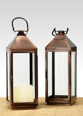 Copper Lanterns for the tables for a more rustic look. These would pair well with the wooden containers.