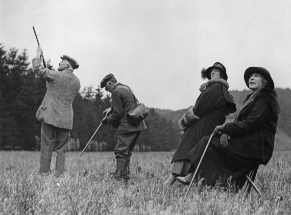 The Duke of Roxburghe, Henry Innes-Ker, 8th Duke of Roxburghe (1876-1932, far left) taking part in pheasant shoot at the house party at the home of Dowager Lady Nunburnholme at Warter Priory, East Yorkshire, 6th Dec 1922.  Looking on are Mary Goelet, Duchess of Roxburge (1878-1937) and Edith Vane-Tempest-Stewart, Marchioness of Londonderry.