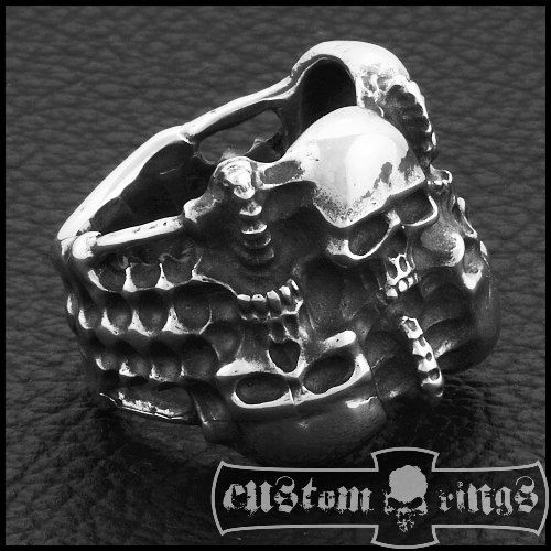 Skulls size: 13 x 9 mm Skull thickness: 5 mm Back width: 8 mm Weight: approx. 20 g Material: .925 sterling silver (NOT PLATED) Manufactured in Poland by Custom Rings Comes with a certificate of originality Join us on Facebook fan page: https://www.facebook.com/CustomRingsFanpage