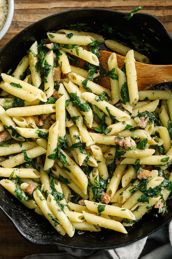For this pasta, garlic is roasted in the oven to bring out its sweetness, then sautéed with bold flavors: salty pancetta, fiery chile flakes and a squeeze of lemon. Chopped peppery arugula and a pound of penne round out the dish. It takes 40 minutes to an hour to roast the garlic, but you can do it a day in advance, and it is worth it for the final, honeyed results. (Photo: Craig Lee for NYT)