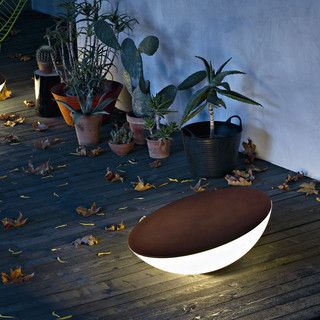 Foscarini Solar Outdoor Floor Lamp $1,547	Solar is a new type of object, a contemporary hearth around which to gather and chat, at home or outside.  The hemispherical body, made of polyethylene, is stable even when it is tilted by 15°.  The angling determines the quantity of light diffused, allowing multiple effects and atmospheres to be created.  This fixture is availble in brown and requires one 25W E26 medium compact fluorescent bulb.  Manufactured by Foscarini.Designed in 2011.