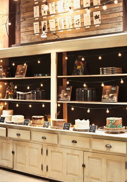 cake display: Cakes Display, Display Lighting, Backgrounds, Cabinets Storage, Cafe Display Cabinets, Bistros Lighting, String Lighting, Bakeries Interiors Decoration, Lighting Cabinets