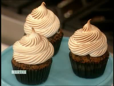Martha Stewart and Jennifer Shea whip up marshmallow frosting to top chocolate graham cracker cupcakes.