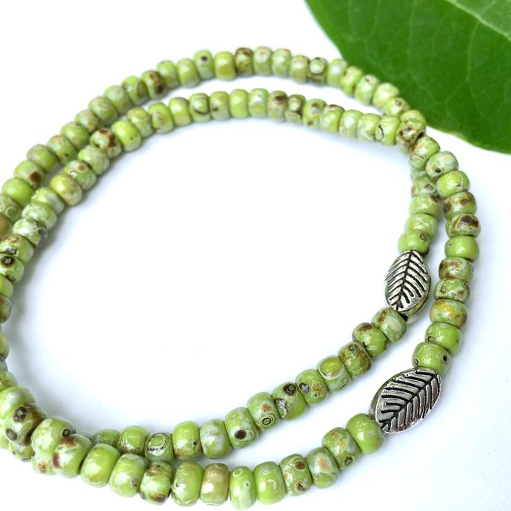 Minimalist stackable bracelets for Earth Day.   Just $12 each. SAVE on 2 or more.   Beautiful Picasso glass beads are paired with a detailed silver leaf.   A unisex style for all ages.   Gift-ready packaging with free original nature-photo gift card.