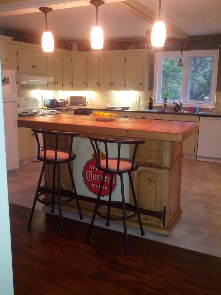 Rustic Pine Bar With A Vintage Corona Sign Featuring As Kitchen Island Tiled