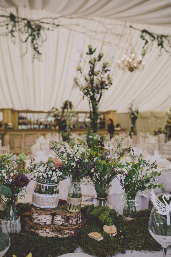Woodsy rustic wedding reception decor | Image by Ten21 Photography
