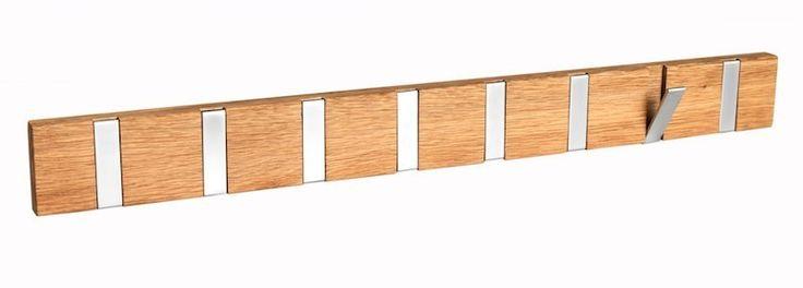 Belina Knagerække - Praktisk knagerække i egetræ med 8 knager i metal. Knagerækken er udført i minimalistisk stil med praktiske knager, der kan klappes ud, hvis der skal hænges noget op. Få plads til overtøjet med denne smarte knagerække.