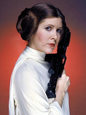 Call them bagel buns, earmuffs, or cinnamon buns—there's no movie hairstyle as iconic—or imitated—as the one Princess Leia wears in the original Star Wars. So how did they come about? Will the buns make an appearance in the new...