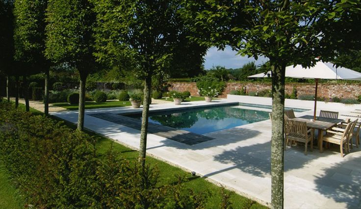 Arun landscapes surrey garden with pleached hornbeam and for English garden pool