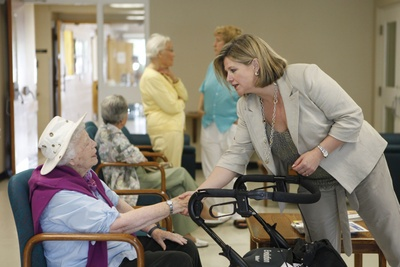 Andrea visits seniors at Waterloo's Adult Recreation Centre Monday.