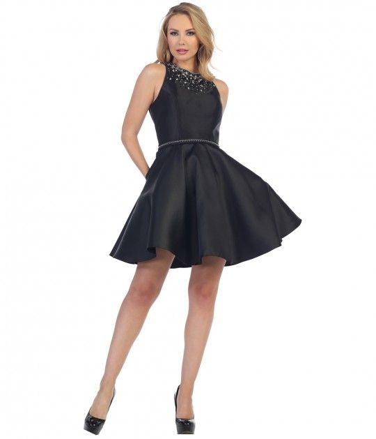 A gorgeous short dress for a special occasion! This beautiful black frock is crafted in a lovely satin, with gentle darting along the waist to create a soft ruffled style. The sleeveless bodice has a high scoop neck with brilliant silver and black embelli