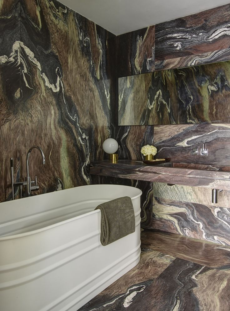 Dramatic brown marble bath in a revived 1932 Miami villa belonging to contemporary furniture dealer Stephan Weishaupt of Avenue Road, Richard-Powers photo | Remodelista