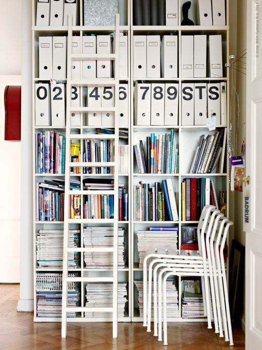 although not a fan of bookcases, i like this for a home office. the labels on those magazine racks are great. just keep me off of that ladder.