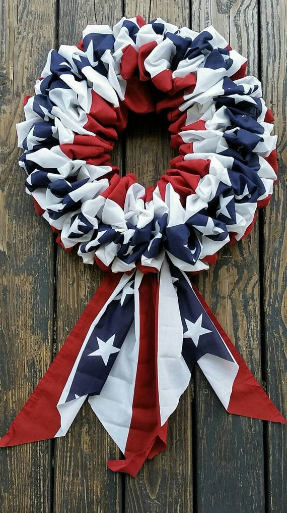 Patriotic Bunting Wreath Simple yet elegant... our patriotic bunting wreath is perfect for all your patriotic decorating needs. Festoon your front door or hang inside. Several yards of red, white, and blue cloth bunting was used to create this wreath. It measures approximately 20 inches
