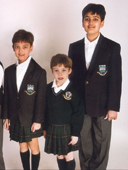 Being in the fifth form, Salim (right) was exempt from having to wear the new boys' uniform. His younger brother was not.