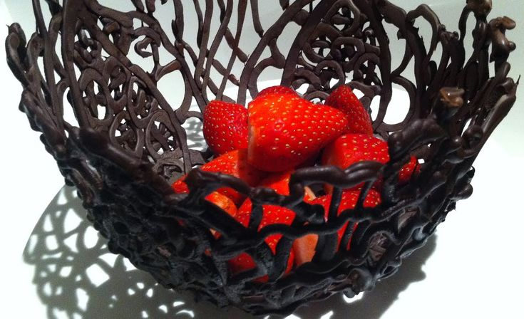 How to make a CHOCOLATE BOWL                          http://www.howtocookthat.net/public_html/how-to-make-chocolate-bowls/                                             http://www.howtocookthat.net/public_html/how-to-temper-chocolate-in-the-microwave/                                                                     http://www.howtocookthat.net/