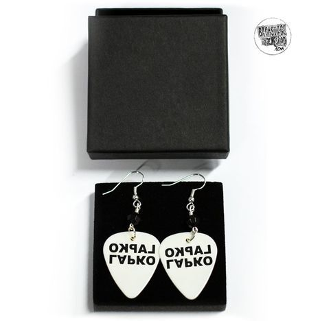 White plectrum earrings, Earrings - Lapko. Designed and made by Jaana Bragge.