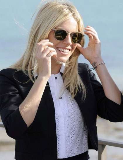 Sienna Miller reveals her swallow tattoo during the Dinard British Film Festival Jury Member in France, October 2010