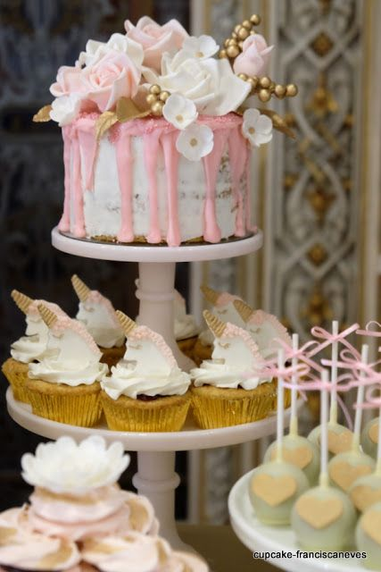 naked dripped cake with sugar flowers and unicorn cupcakes