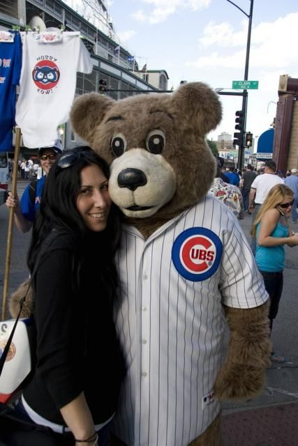 Image of A fan w/ a Chicago Cubs Mascot