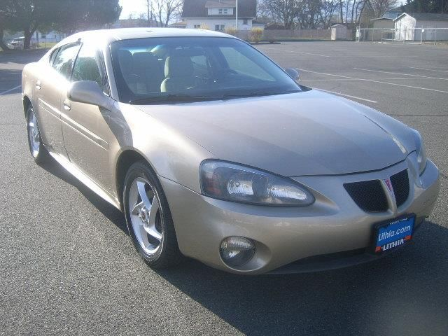 2004 Pontiac GrandPrix GTP 4dr Sedan GTP Sedan 4 Doors Gold for sale in Medford, OR http://www.usedcarsgroup.com/used-2004-pontiac-grandprix-medford-or-2g2wr524141362124