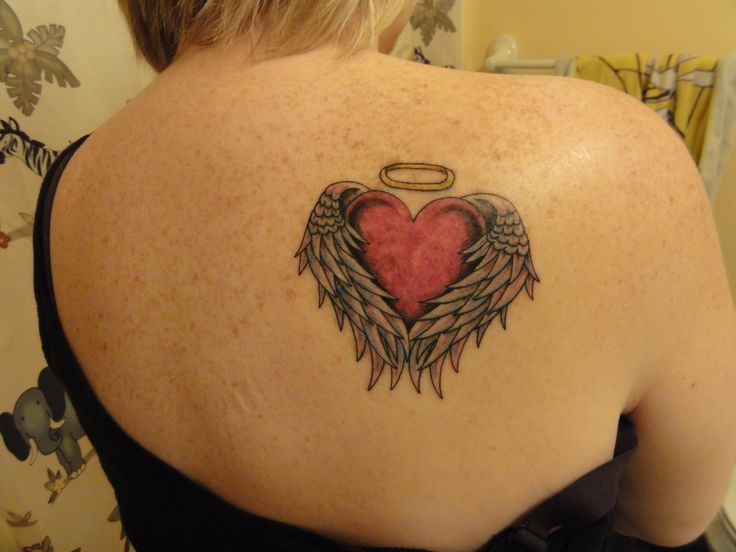 This is my tattoo!! I got it in memory of my daddy who lost his battle to cancer on February 16, 2003.  It symbolizes his angel wings surrounding my heart and protecting me.  I will always carry him with me, each and everyday.