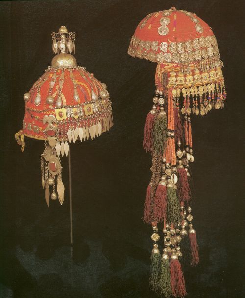 Caps of marrigable girls of N Afghanistan. Style of embroidery of left cap is N. Afghan Turkmen,crown element is of Tekke style and plait of Ersari. Right, both embroidery and elements of Lakai Uzbek, fire guilded parts indicative of Khiva.