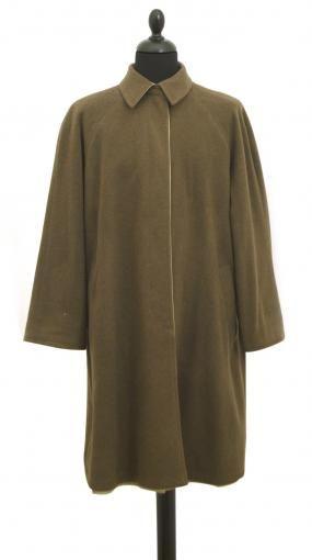 Original 1980's waterproof double face coat by Reverso. The waterproof side is light beige, side coat is moss green