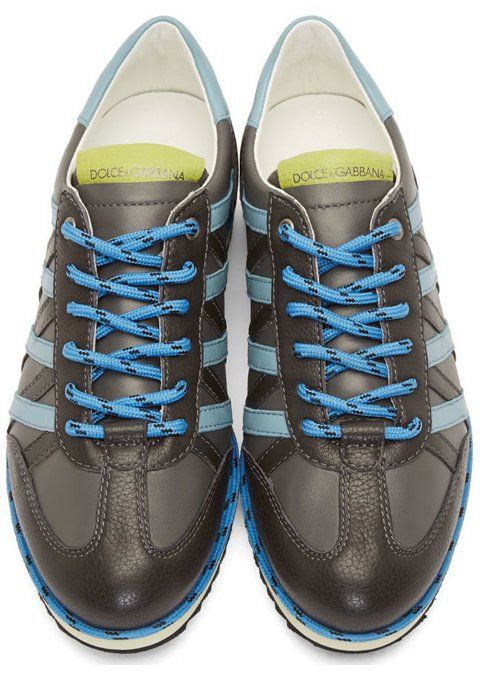 Grey Striped Leather Sneakers by Dolce & Gabbana. Low-top sneakers in grey. Grained leather trim throughout in dark grey. Round toe. Lace-up closure in cornflower blue. Matching lace trim at welt. Buffed leather trim in powder blue at heel collar and sides. Grained leather logo patch at tongue in chartreuse. http://www.zocko.com/z/JG9zC