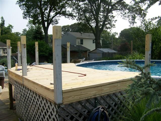 Decks for up ground pools deck around above ground pool for Above ground pool decks off house