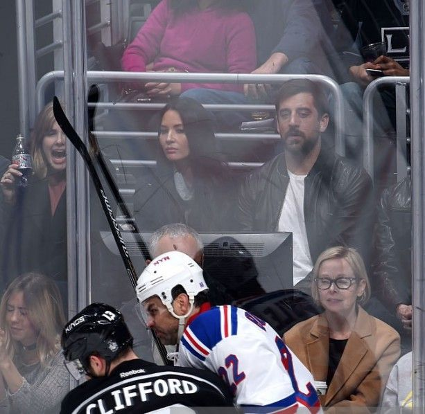 Actress Olivia Munn and Green Bay Packers Quarterback Aaron Rodgers attend a game between the Los Angeles Kings and the New York Rangers at STAPLES Center last night in Los Angeles. The Announcer pointed out the happy couple, but called Munn his wife. Does this guy know something we don't?-TO @BarstoolBigCat Jim Fox must be