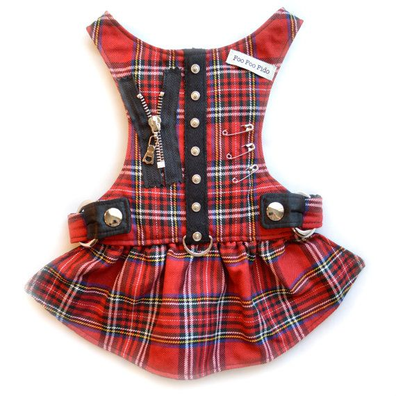 Dog Harness Red and black plaid with stud detail, zipper and safety pins. Dog Harness Dress This is also available in a Harness Vest Adjustable at shoulders and waist. NO VELCRO Fully lined and Washable.  Matching Leash available under our store section Leashes  *Patent Pending* As cute as the harnesses are, there is sturdy nylon webbing under the decorative fabric holding the D ring that connects to your leash. The D ring is placed at the bottom of the harnesses, (not at the neck).  Also…