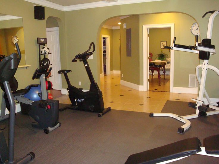 The big arch makes this basement home gym very inviting to