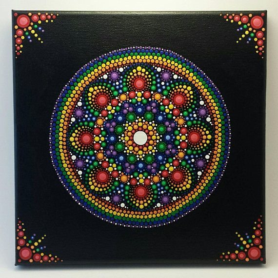 This Rainbow Mandala has been hand painted with acrylic paints on a 10×10 stretched canvas. It has been sealed with Kamar Varnish for protection! A beautiful and unique way to cheer up any space!! Canvas will be shipped in a large Priority Flat Rate Box for safe keeping. *** Please