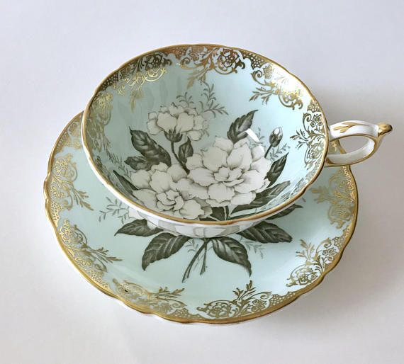 Vintage Paragon Gardenia china tea cup, saucer and plate made in England. An aqua ground with beautiful white gardenias on both the cup and saucer. Both pieces are in good condition, no chips, cracks or crazing. Please Note: The items I sell are not new, they are vintage or