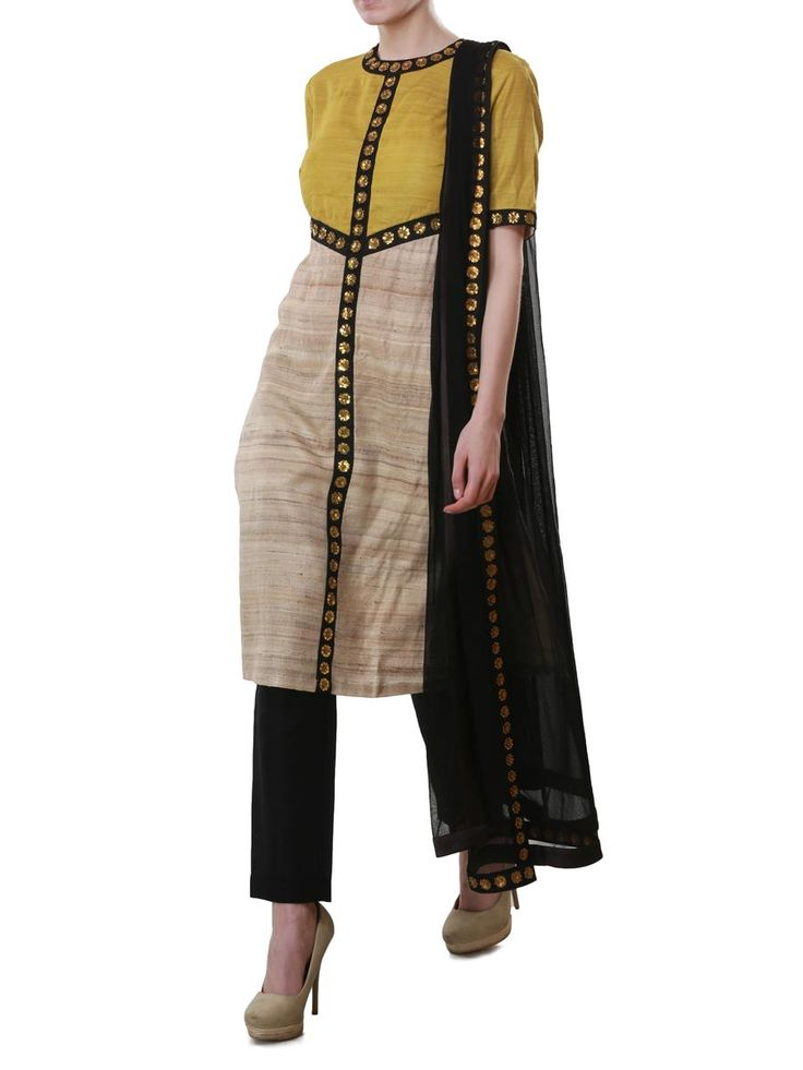 Mustard and beige kurta | Priyal Prakash | BYELORA.COM Priyal Prakash's two tone mustard and beige tussar silk indian designer kurta is softly shaped with black, panels under the bust and down the middle. The a cut-away back and loose fit adds effortless appeal and drama while black accents repeated around the neck line and at the sleeves finish off the overall look. - See more at: http://www.byelora.com/Shop/Priyal-Prakash/Mustard-and-beige-kurta#sthash.lkglrlqt.dpuf