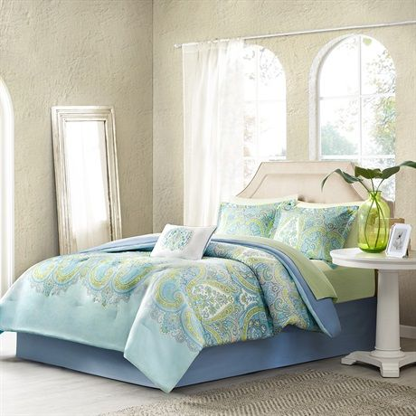 Celeste will brighten up any bedroom. This aqua blue comforter features a green, blue, and yellow paisley print that adds style and flair. The comforter reverses to a solid blue. The white decorative pillow features beautiful yellow and blue embroidery and blue piping. This complete bed set also includes two matching standard shams and a yellow and white diamond dot print sheet set that matches the yellow on the face of the comforter. The decorative accents pull the whole look together. Made…