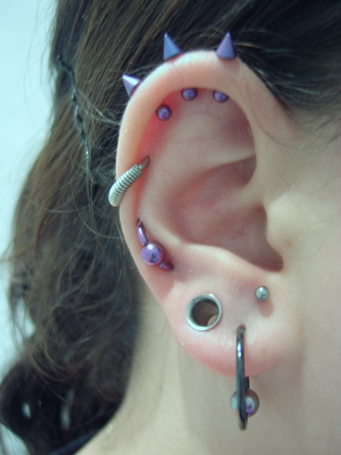 i absolutely love the purple spikes at the top cartilage tattoos piercings. Black Bedroom Furniture Sets. Home Design Ideas