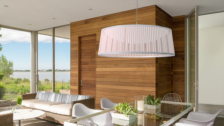 Designed by Carmine Deganello, the Solis Drum pendant is a very engaging light as it blends light and shadows together. The incorporated LED dome diffuser helps span the light throughout the fixture to cast shimmering warm patterns onto the space that surrounds it. See more LED lights at LightForm.ca