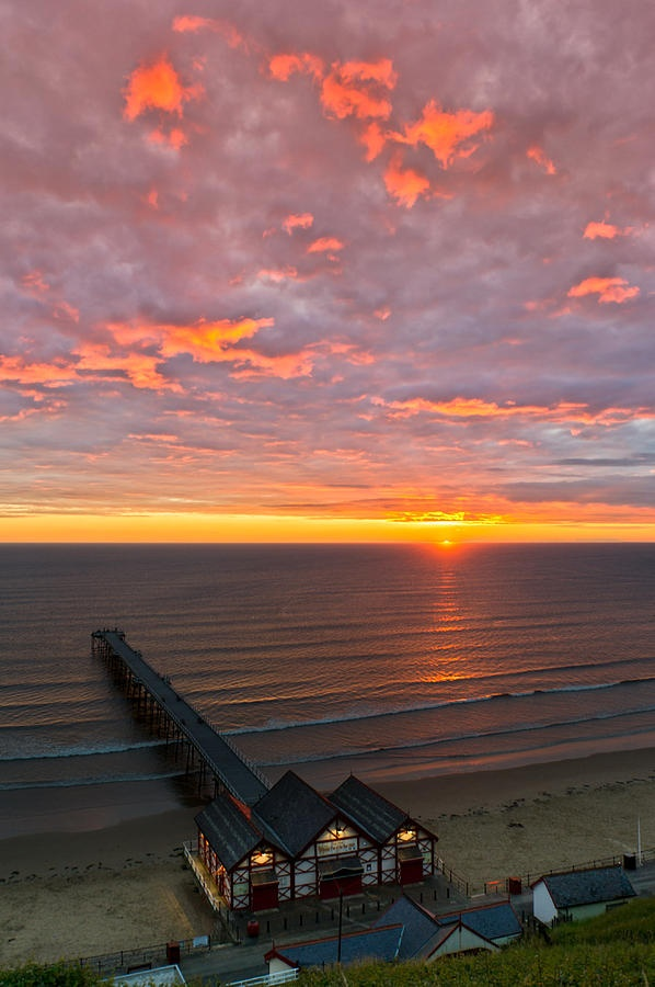 ✮ The first rays of dawn slip over the North Sea horizon at Saltburn by the Sea in North Yorkshire on the North East coast of England
