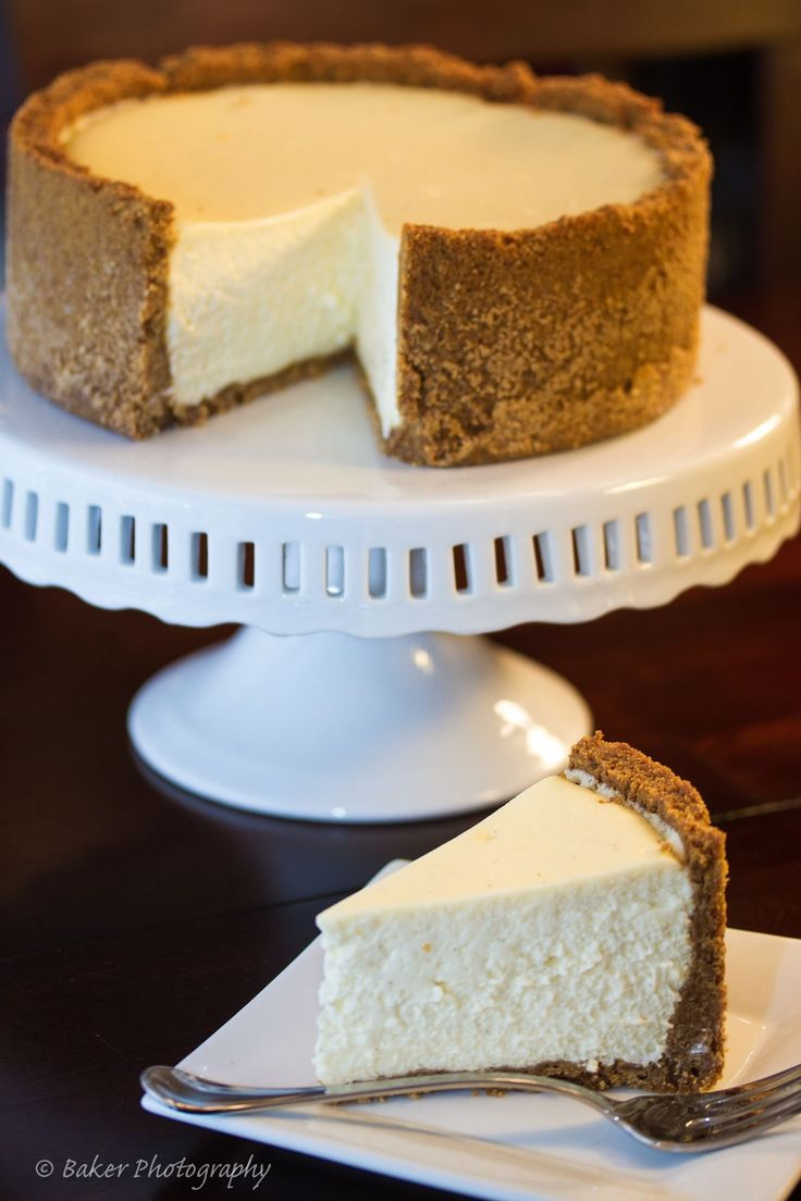 Recipe for vanilla bean cheesecake with the perfect graham cracker crust.