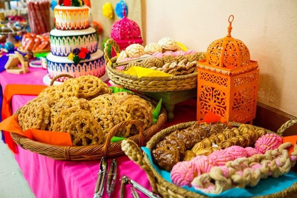Mexican Fiesta Cinco de Mayo dessert table :: I love the mexan breads! would be great alternative to cupcakes::