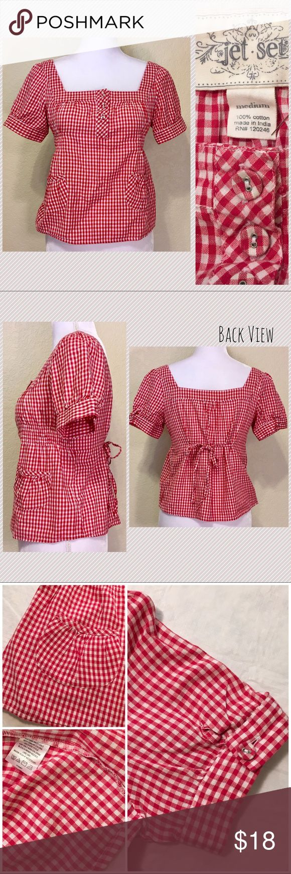 """Jet Set Red Gingham Crop Top Jet Set Red Gingham Crop Top.  Size M.  Excellent condition.  Pleated button sleeves.  Two pleated front pockets.  Three button bodice.  Front side elastic.  Attached back tie.  Length shoulder to hem: 20"""".  Waist/across elastic: 17.5"""" across.  Bottom: 20"""" across.  Sleeve length: 8"""".  Cuff width: 6"""".  100% cotton.  Machine wash cold, line dry.   Love it but not the price - I'm open to (reasonable) offers! Jet Set Tops Crop Tops"""