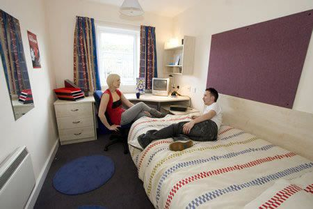 Liberty Park bedroom. All bedrooms are ensuite, and come with 4ft bed with under-bed storage, double wardrobe with shelf and hanging rail, a desk with storage, wall shelf, three-drawer chest of drawers, notice board and mirror. Top tip from students - buy wicker baskets which you can put on the top of the wardrobe for additional, out of the way storage.