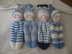 """dolls made from socks -- I ADORE these.  They are so sweet and simple and cuddly for a very young baby and a toddler, too.  Make a tiny one from an infant sock and put in a quiet book  that has a little pocket """"bed.""""   Use a french knots for eyes --safer than beads."""