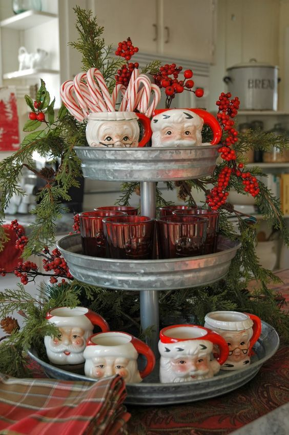 a hot chocolate station with a galvanized stand and vintage cups